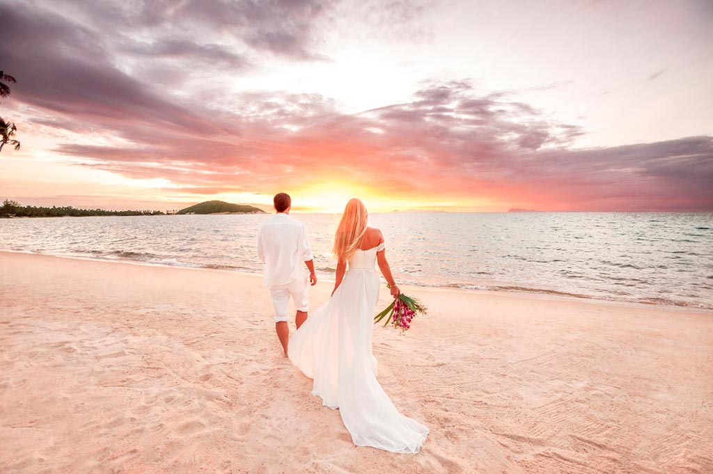 Couple on a beach at a destination wedding